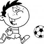 Chłopiec piłkarz z piłką